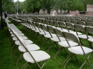 We never needed this many chairs, but if we had you can bet the row to the far right would be un-sat-in (Wikimedia)